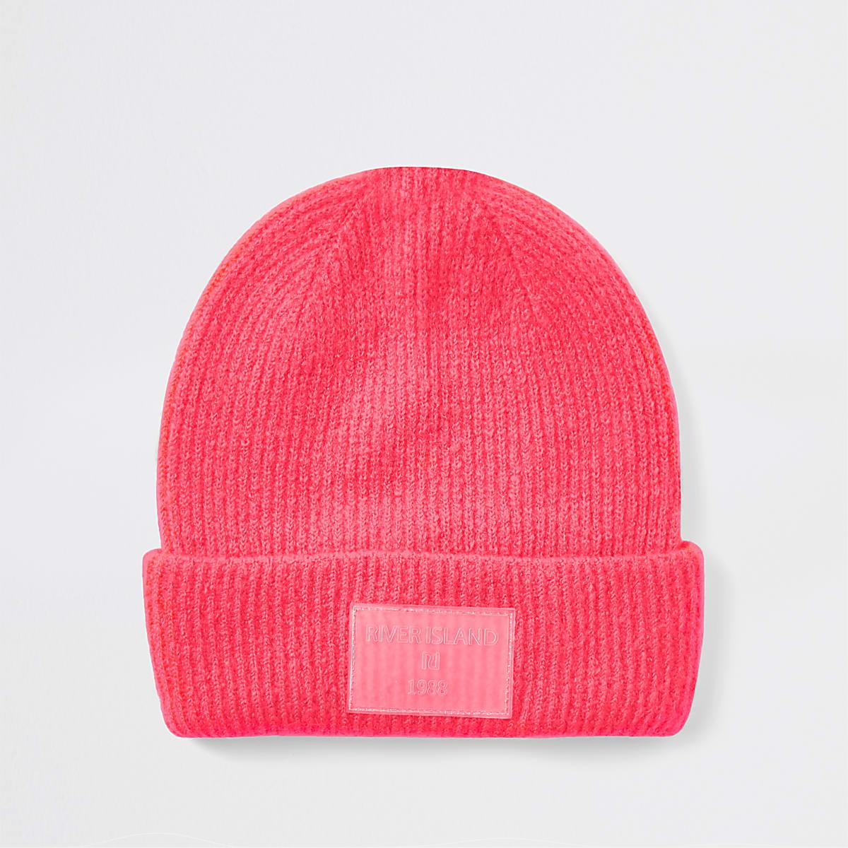 Bright pink beanie hat