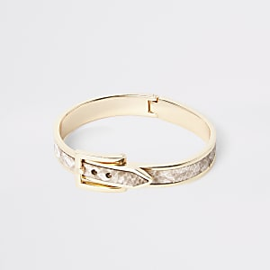 Goldenes Armband in Schlangenlederoptik