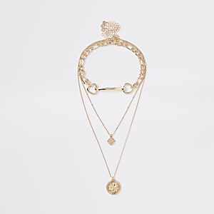 Gold tone snaffle chain layered necklace