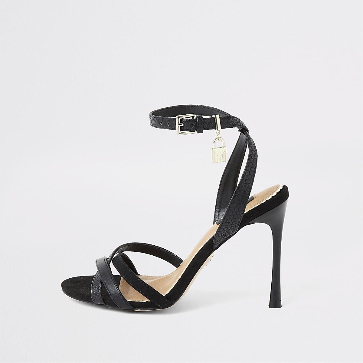 Sandales coupe large minimalistes noires avec cadenas