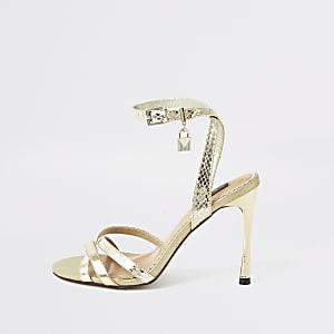 Goudkleurige minimalistische sandalen met hangslot en brede pasvorm