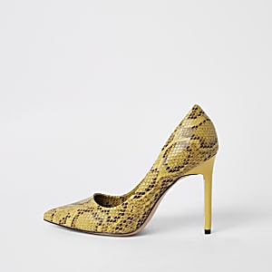 Gele pumps met slangenprint