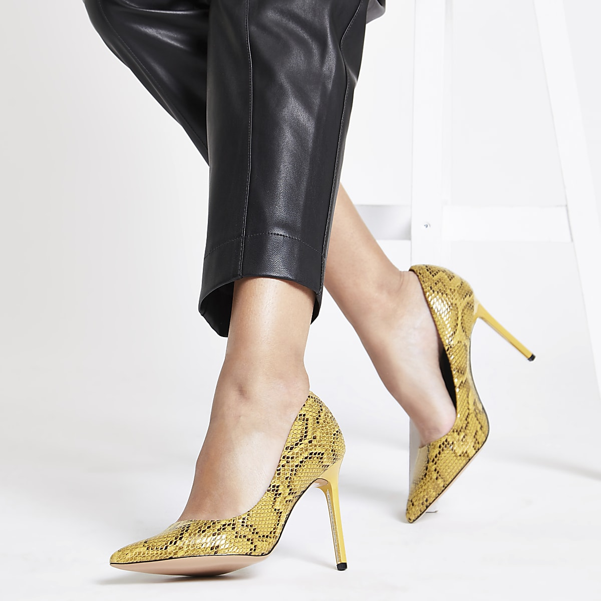 ccfd4198254 Yellow snake print court shoes