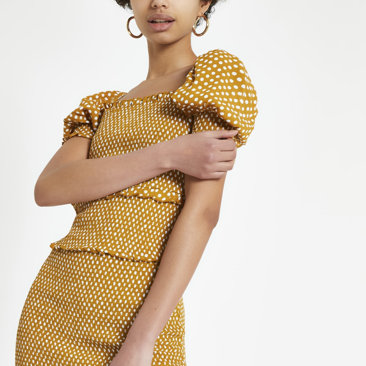 Yellow spot shirred crop top