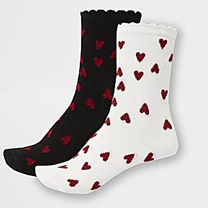 2 paar witte en zwarte sokken met hartenprint