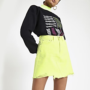 Neon yellow mini denim skirt