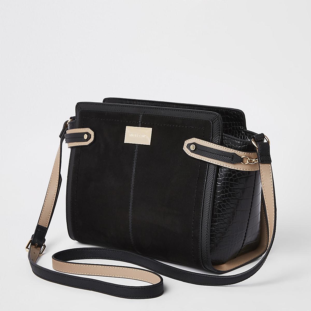 Zwarte crossbodytas met gesp aan de zijkant
