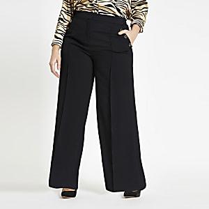 RI Plus - Zwarte broek met knopen en wijde pijpen