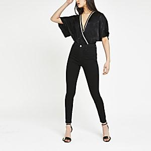 Zwarte bodysuit met slangenprintbies