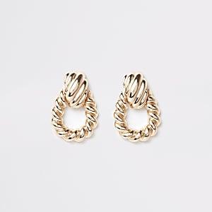 Boucles d'oreilles dorées à grand motif heurtoir torsadé