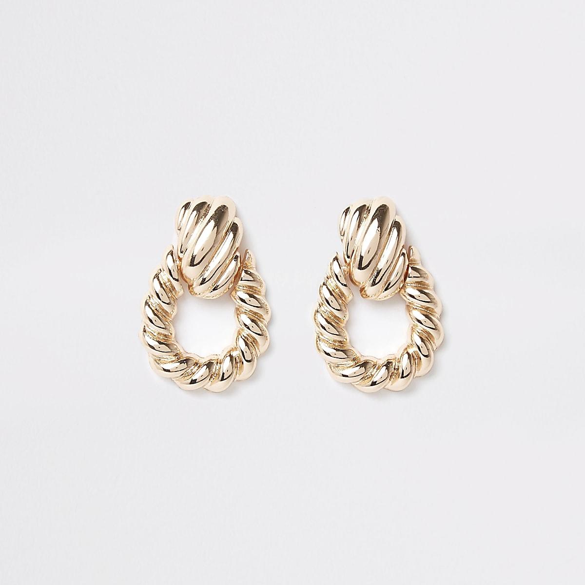 Gold color large twist doorknocker earrings