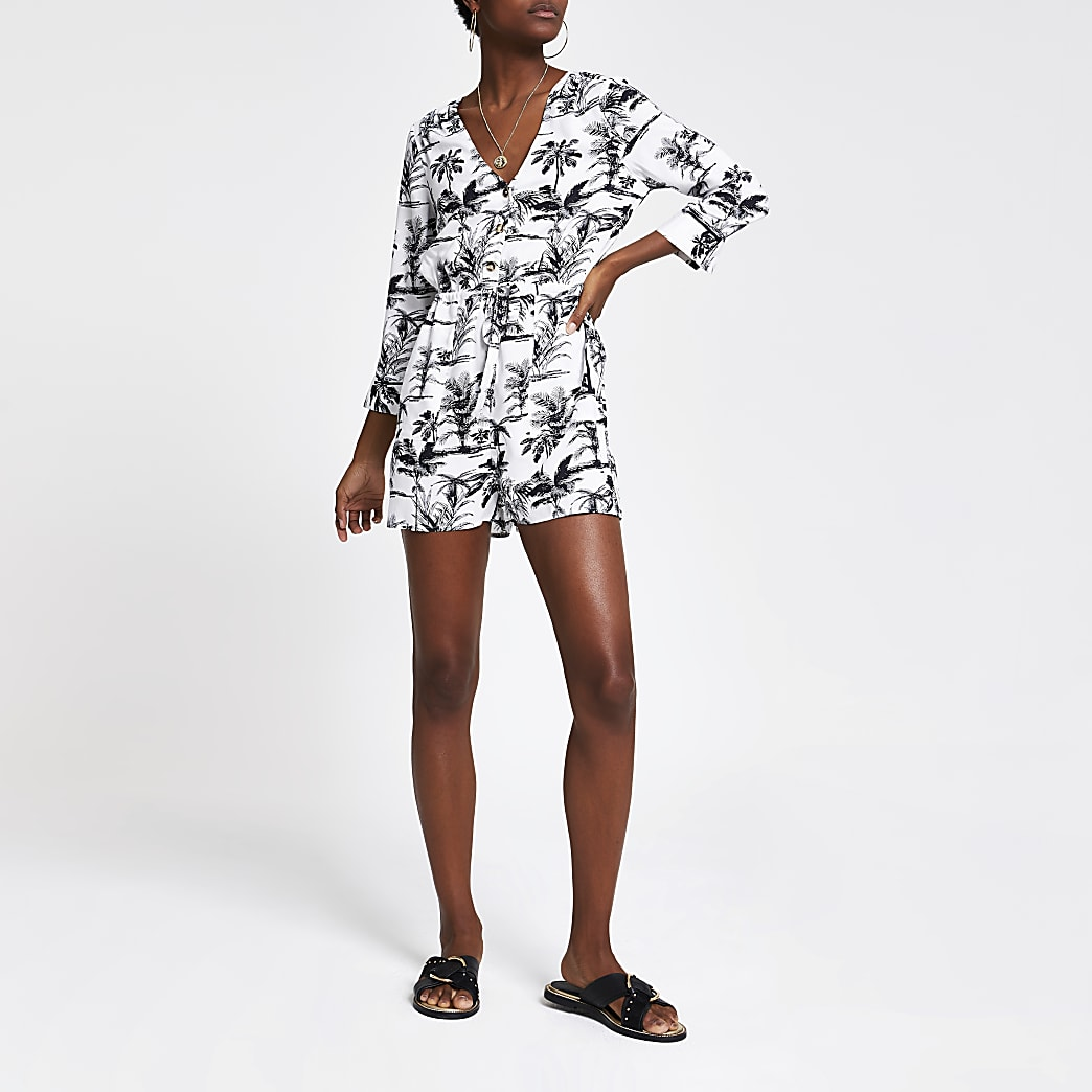 Marineblauwe playsuit met palmboomprint