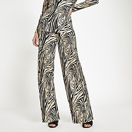 Cream plisse zebra print wide leg trousers