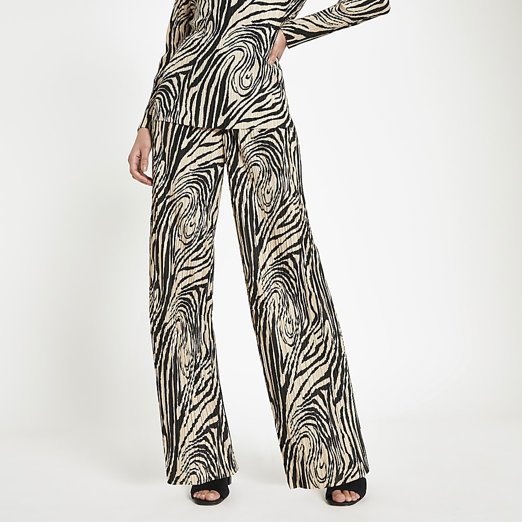 Crème plissé broek met zebraprint en wijde pijpen