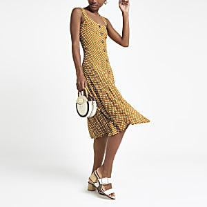 Gele midi-jurk met stippen en knopen
