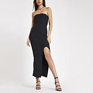 Zwarte geribbelde bandeau maxi-jurk met split voor