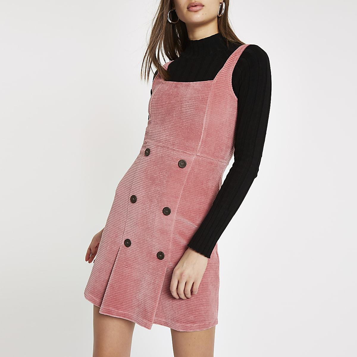 Roze corduroy overgooier met knopen voor