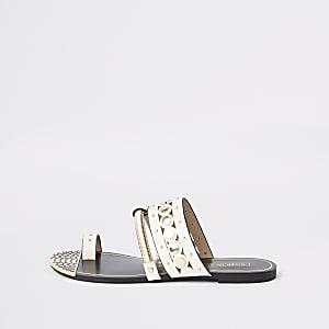 Witte sandalen met teenlus en goudkleurige rand