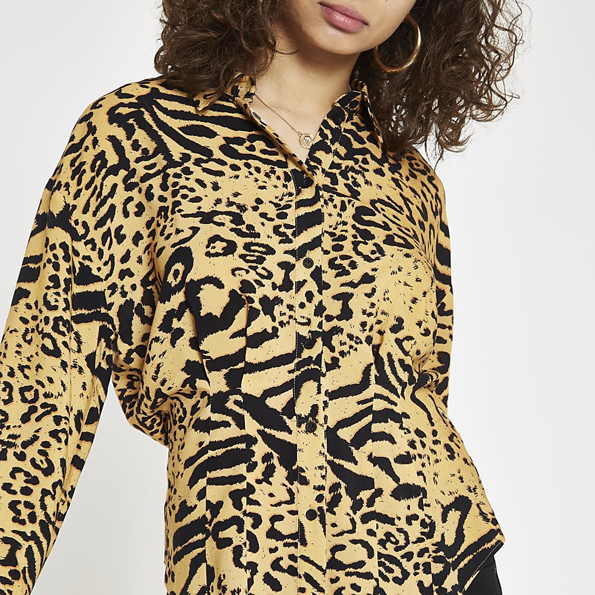 Orange leopard print tucked waist shirt
