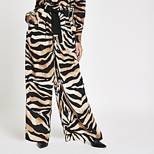 Brown wide leg tiger print trousers