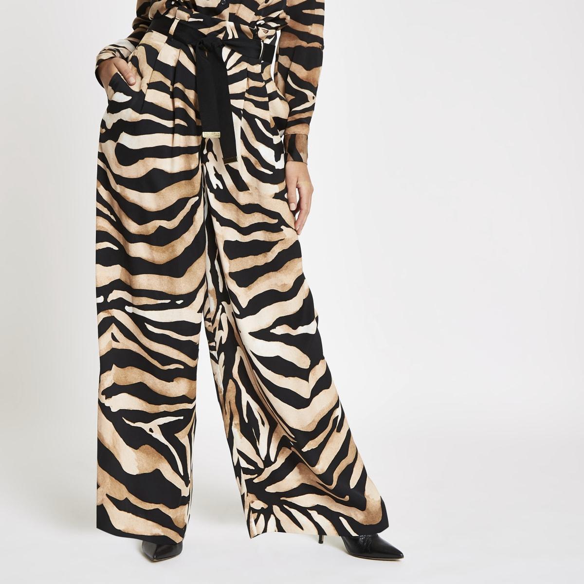 Bruine broek met wijde pijpen en tijgerprint