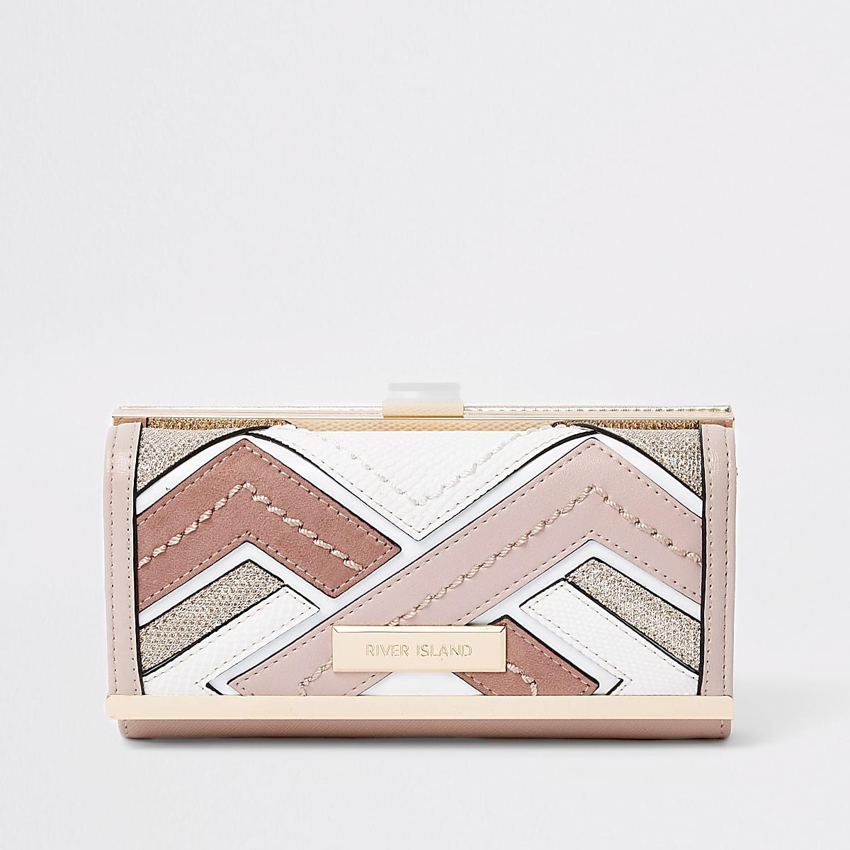 Portefeuille rose clair à paillettes et découpes avec fermoir clip