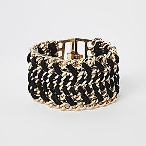 Goudkleurige armband met zwart draad en sluiting