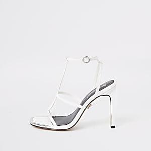 Sandales blanches à talons et lanières