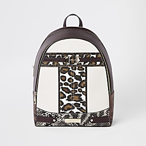 Brown animal print snaffle front backpack