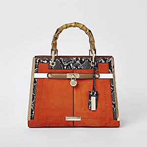 Orange lock front bamboo handle tote bag