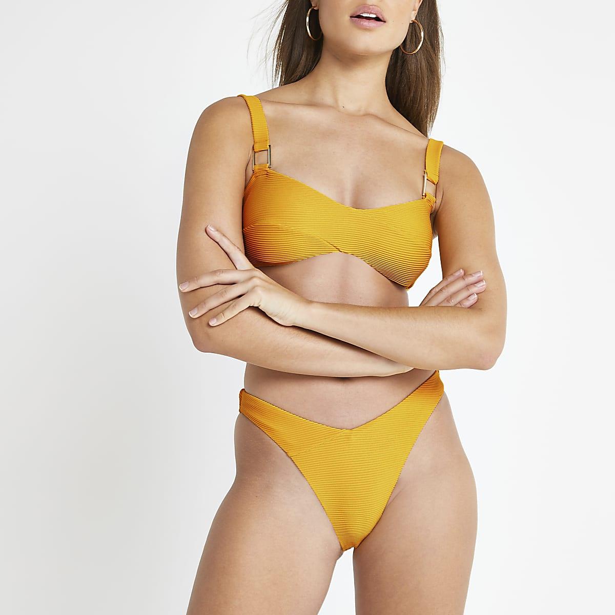 Oranje hoog uitgesneden bikinibroekje met V voor