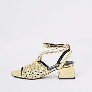 Goudkleurige gevlochten sandalen met blokhak