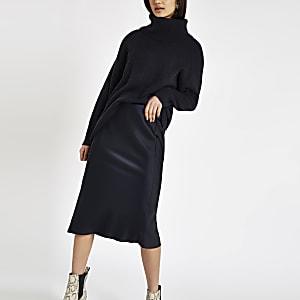 Jupe mi-longue bleu marine coupée en biais