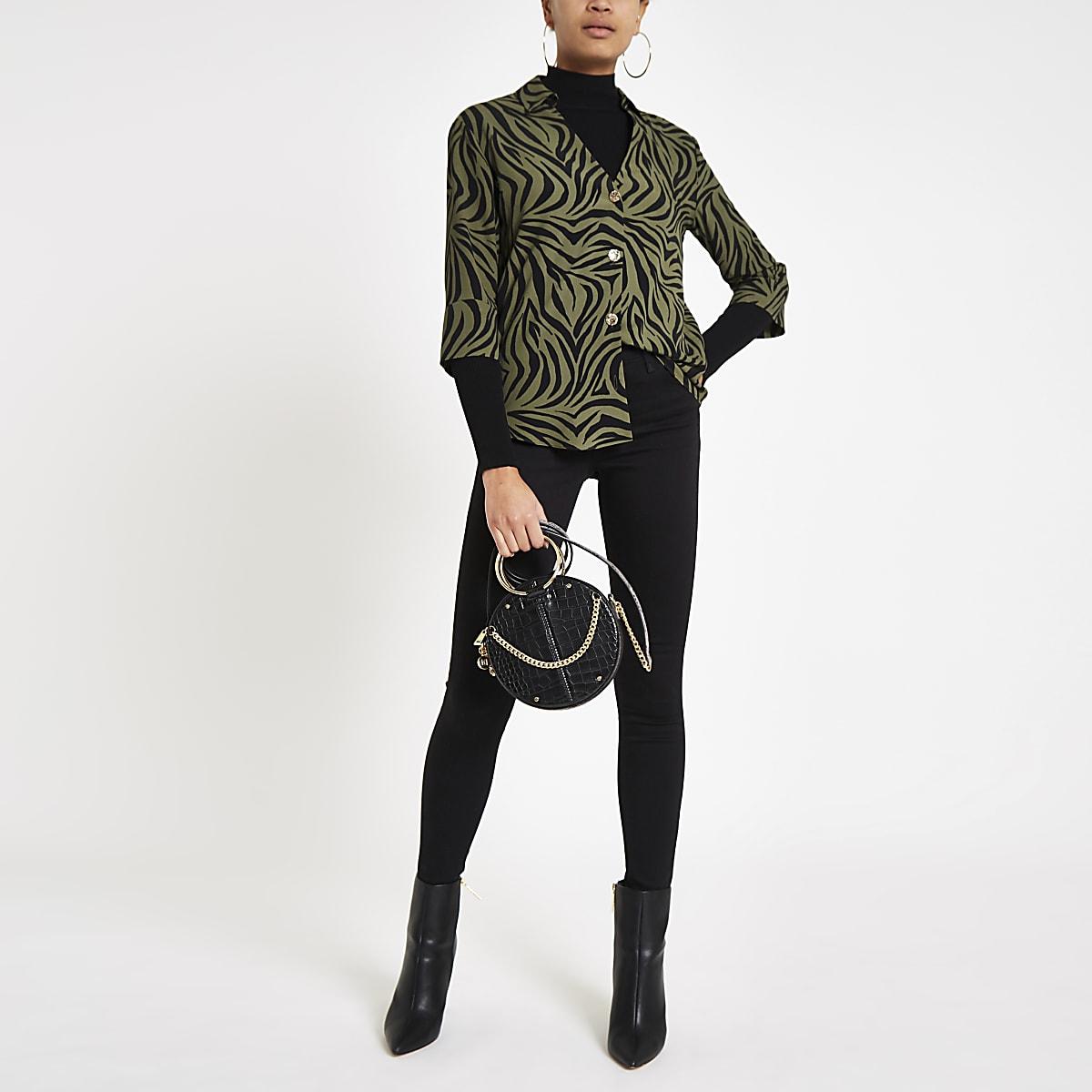 Kaki blouse met tijgerprint en open achterkant
