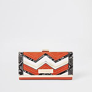 Porte-monnaie orange avec zigzags serpent et fermoir clip