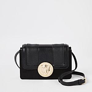 Zwarte mini-crossbodytas met leeuwenhanger