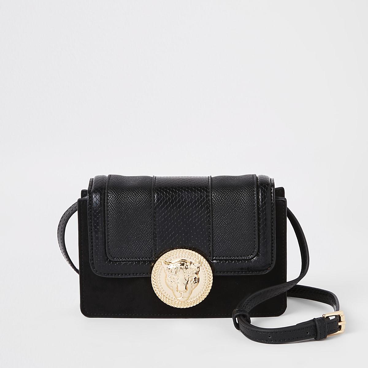 Black lion pendant cross body mini bag