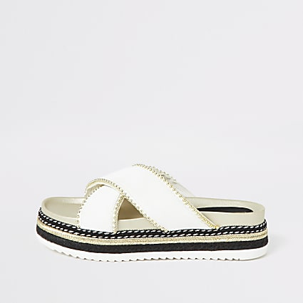 White cross studded flatform sandals