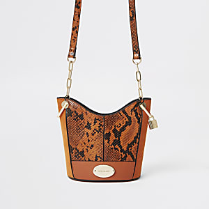 Orange snake print bucket bag