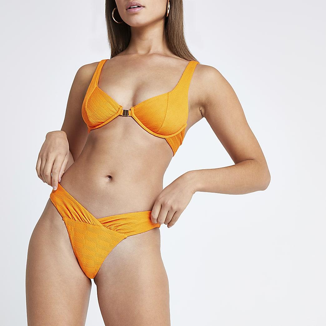 Oranje hoog uitgesneden bikinibroekje met V voor en ruches