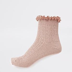 Socken in Koralle mit Rüschen