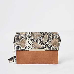 Oranje leren onderarmtas met slangenprint