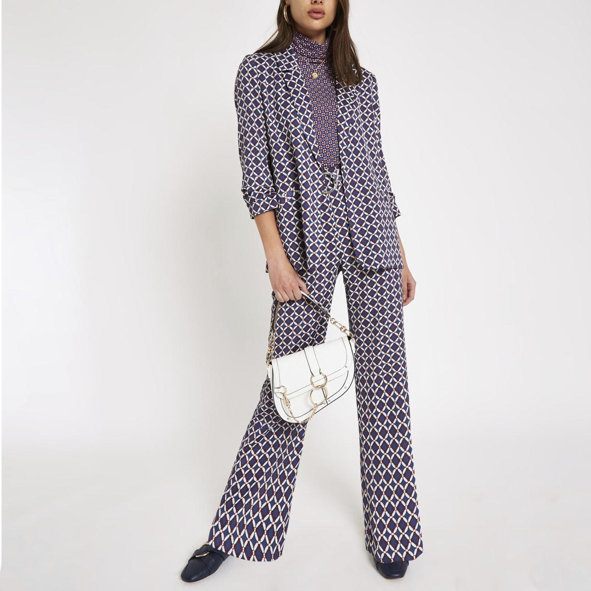 Pantalon large imprimé bleu avec boucles en D