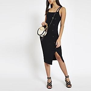 2950d250dab1cc Zwarte geribbelde asymmetrische midi-jurk met knopen opzij