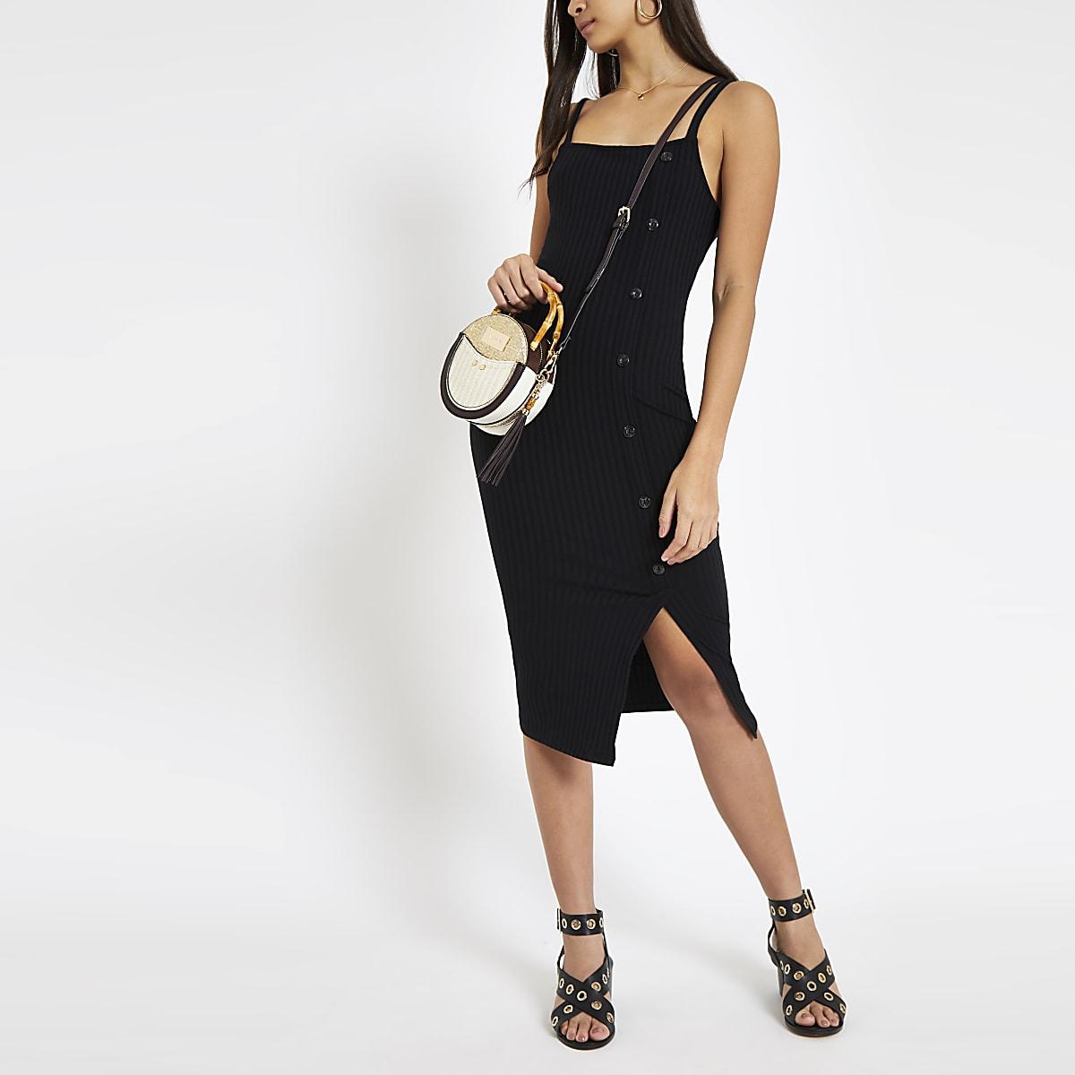 49822f495a08a7 ... Zwarte geribbelde asymmetrische midi-jurk met knopen opzij ...