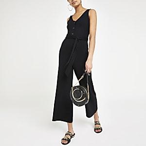 Zwarte geribbelde jumpsuit met V-hals en strikceintuur