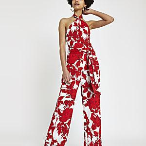 Forever Unique - Rode jumpsuit met print en halternek