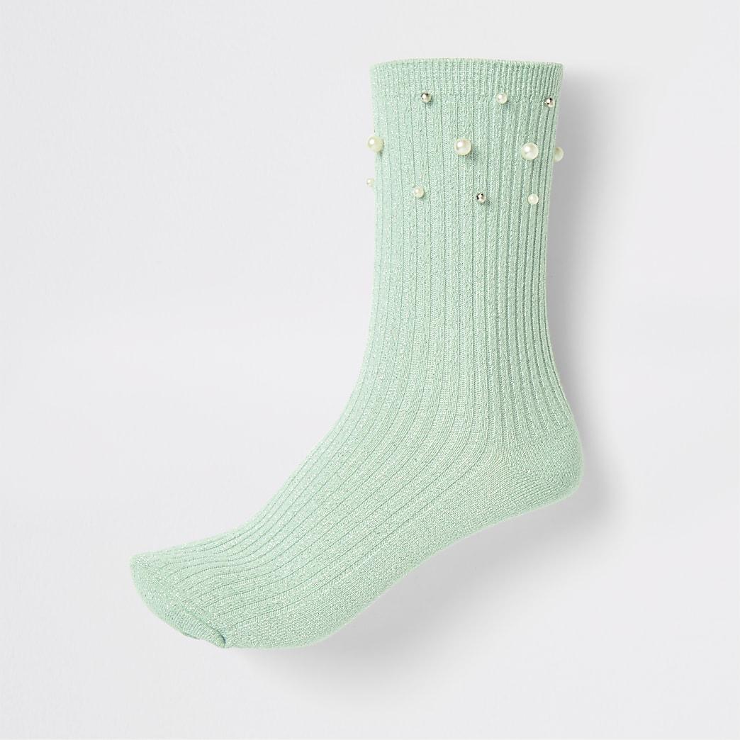 Socquettes vert clair bordées de perles