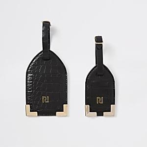 Set zwarte bagagelabels met krokodillenreliëf