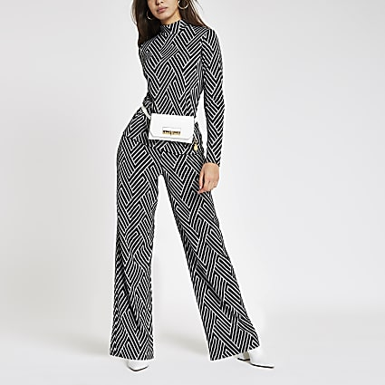 Black geo print wide leg jersey trousers